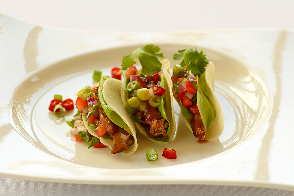 Kalbi Chicken Tacos with Red Onion Salsa ':' Great anytime, this dish is a refreshing twist to a family favourite.